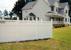 White fencing wth lattice